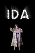 Ida Crolina reaching towards the camera under her name in lights