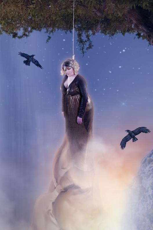 Close up of Ida Carolina dressed as Odin hanging himself from the world tree