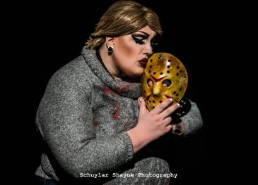 Ida Carolina dressed as Pamela Voorhees kissing the Jason mask