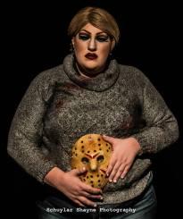 Ida Carolina dressed as Pamela Voorhees holding the Jason mask over her belly