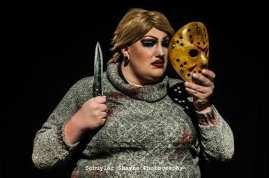 Ida Carolina dressed as Pamela Voorhees holding a knife and the Jason mask