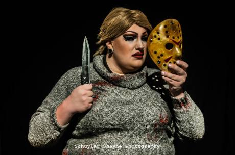 Ida Carolina dressed as Pamela Voorhees holding a knife and the Jason mask