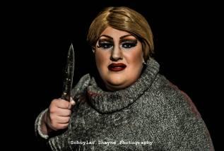 Ida Carolina dressed as Pamela Voorhees holding a knife up