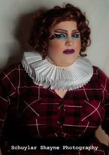Ida Carolina in a neck ruff and plaid dress